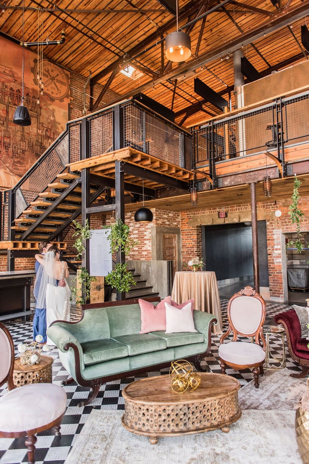 Velvet vintage sofa and chairs with antique rugs and wood carved coffee table in an industrial lounge